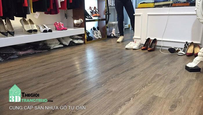 Thi công lót sàn gỗ, lát sàn nhựa gỗ tại quận 7 tphcm . Sàn nhựa gỗ tự dán Golden Floor - Thế Giới Trang Trí 3D